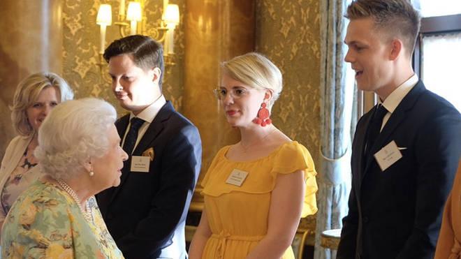 Caspar Lee with the Queen