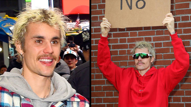 Justin Bieber moustache with dude with sign