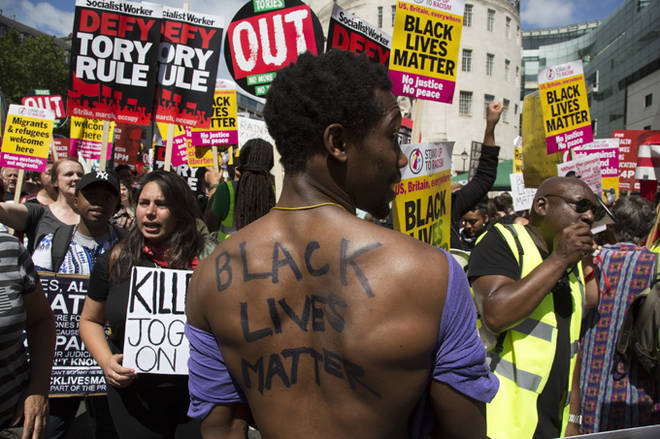 Black Lives Matter supporters at the Peoples Assembly demonstration: No More Austerity - No To Racism - Tories Must Go