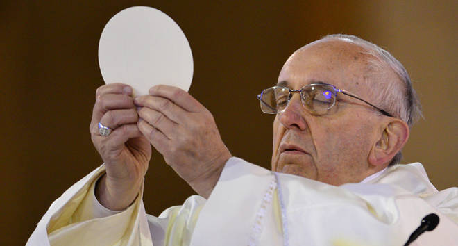 Pope Francis holds communion as he celebrates Mass at the Basilica of the National Shrine of Our Lady Aparecida on July 24, 2013 in Aparecida, Brazil.
