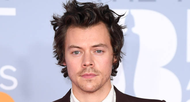 Harry Styles' new movie suspended filming after a coronavirus diagnosis on set.