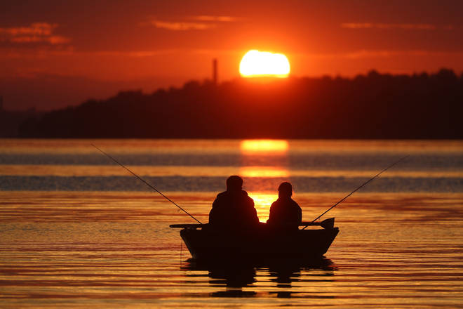 A silhouette of people fishing in Ivanovo Region, Russia