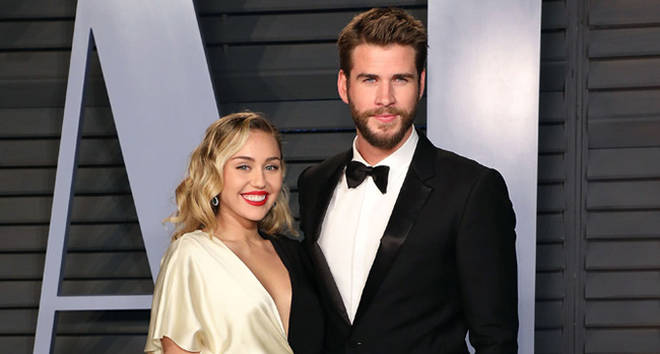 Miley Cyrus and Liam Hemsworth attend the 2018 Vanity Fair Oscar Party.