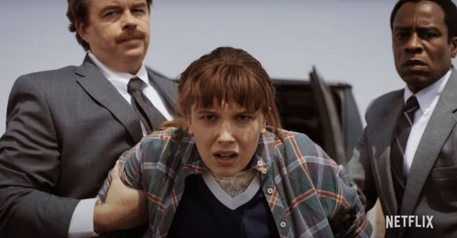 Eleven appears to be kidnapped by men in suits in Stranger Things 4