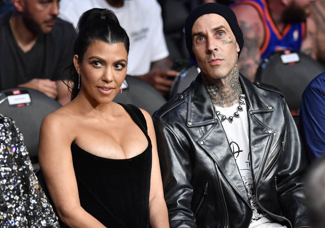 Kourtney Kardashian and Travis Barker are seen in attendance during the UFC 264 event