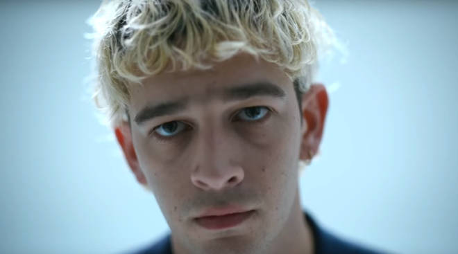 Matty Healy in the The 1975's 'Love It If We Made It' music video