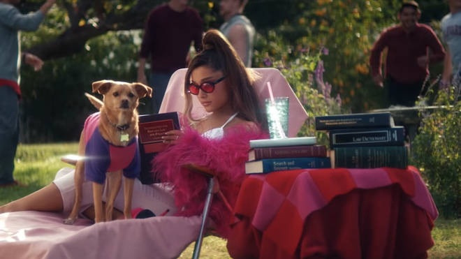 Ariana's Legally Blonde tribute features a book about Immigration and Refugees