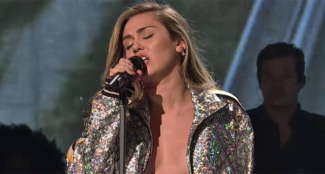 Miley Cyrus performing on Saturday Night Live.