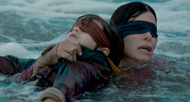 Malorie in the water with Boy in 'Bird Box'