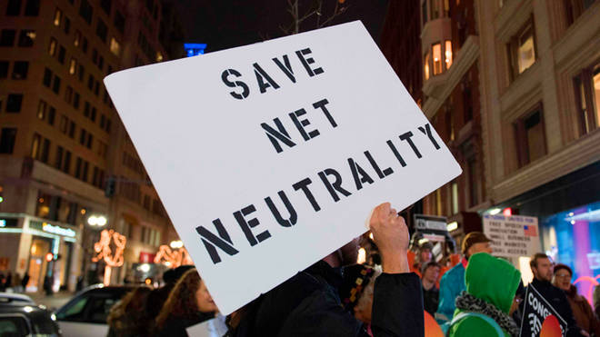 US-FCC-PROTEST-NET NEUTRALITY Protestors gather on Bolyston Street in front of a Verizon store during a Net neutrality rally (RYAN MCBRIDE/AFP/Getty Images)