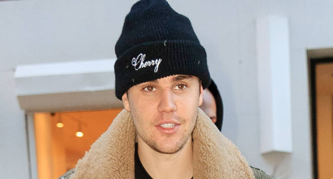 Justin Bieber shows off a 'Drew' shirt when out and about on February 26, 2019.