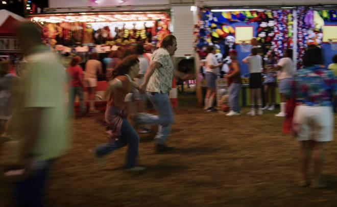 Joyce and Hopper escape the villains at the fair