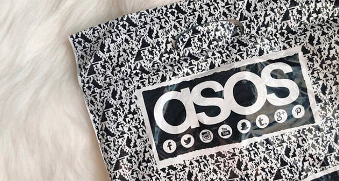 ASOS bag on fur rug.
