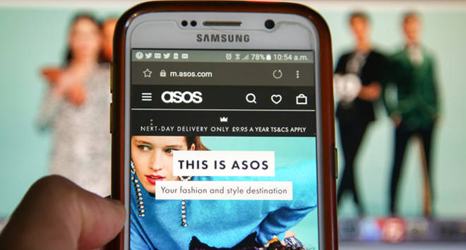 A woman is seen shopping on ASOS the online fashion store on a mobile phone.