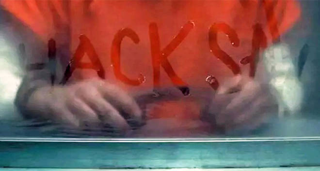 Hacksaw written on the glass in 'Extremely Wicked, Shockingly Evil and Vile'.