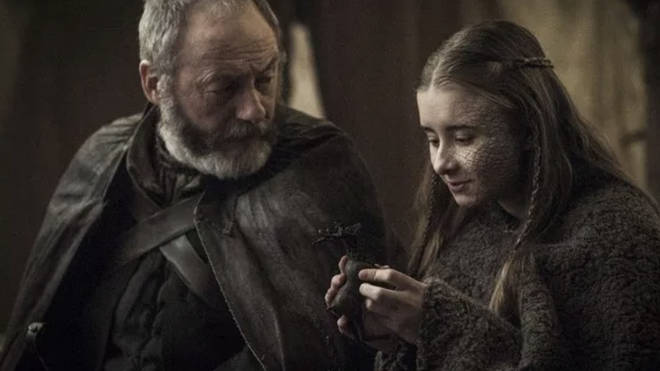 Shireen Baratheon and Ser Davos read about Jon Snow's lineage in a book about Aegon Targaryen