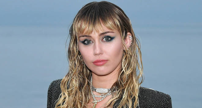 Miley Cyrus attends the Saint Laurent Mens Spring Summer 20 Show.