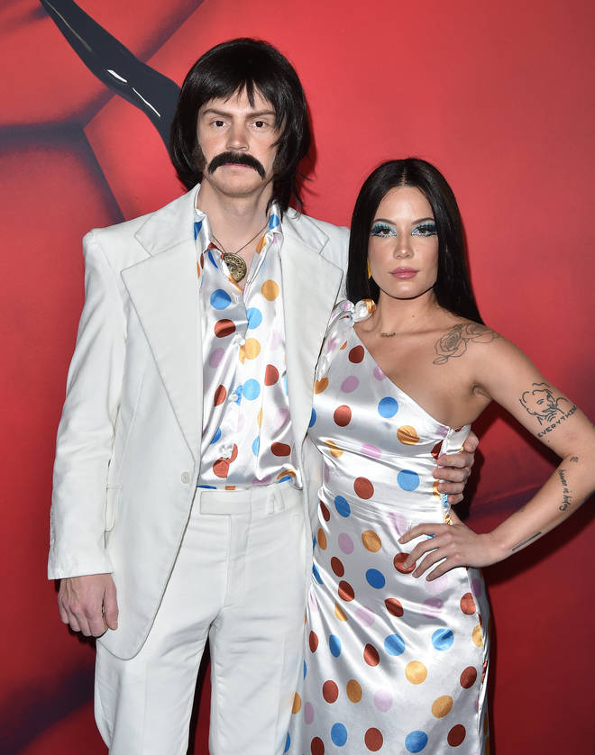 Evan Peters and Halsey dressed as Sonny and Cher at American Horror Story 100th episode party